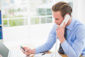 Businessman on the phone while text messaging — Stock Photo