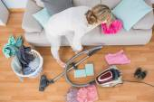 Woman cleaning her chaotic room — Stock Photo