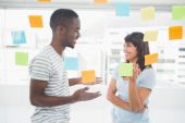 Coworkers standing and interacting together — Stock Photo