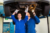 Team of mechanics working together — Stock Photo