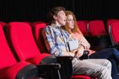Astonished young couple watching a film — Stock Photo
