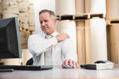 Warehouse manager suffering from shoulder pain — Stock Photo