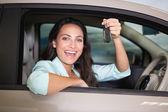 Smiling woman holding car key — Stock Photo