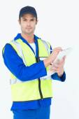 Confident supervisor writing notes on clipboard — Stock Photo