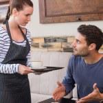 Waitress bringing man coffee and tart — Stock Photo #65540525