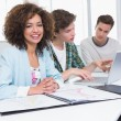 Students working together with laptop and pictures — Stock Photo #65540639