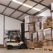 Forklift in a large warehouse — Stock Photo #65541003