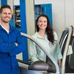 Mechanic smiling with customer — Stock Photo #65542007