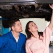 Mechanic showing customer the problem with car — Stock Photo #65542173