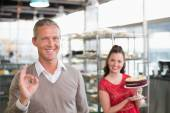 Cafe owners smiling at camera — Stock Photo