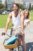 Cute couple on a bike ride — Stock Photo