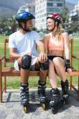 Fit couple getting ready to roller blade — Stock Photo