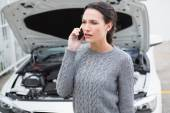 Annoyed woman talking on the phone — Stock Photo