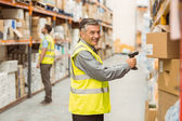 Warehouse worker scanning barcode on box — Foto Stock