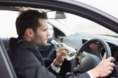 Young businessman driving while drunk — Stock Photo