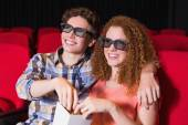 Young couple watching a 3d film — Stock Photo