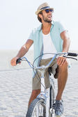 Handsome man on a bike ride — Stock Photo
