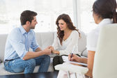 Reconciled couple smiling at each other — Stock Photo