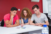 Concentrated students working together — Stock Photo