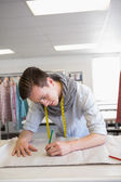 Fashion student drawing on pattern — Stock Photo