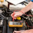 Mechanic using diagnostic tool on engine — Stock Photo #65552317