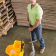 Man moping warehouse floor — Stock Photo #65552379