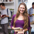 Student carrying small pile of books — Stock Photo #65552521