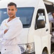 Painter smiling leaning against his van — Stock Photo #65552703