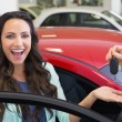 Excited woman receiving car key — Stock Photo #65552797