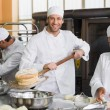 Team of bakers working together — Stock Photo #65553193