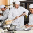 Team of bakers working together — Stock Photo #65554001