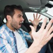 Young man experiencing road rage — Stock Photo #65555301