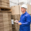 Warehouse worker checking his list — Stock Photo #65556055