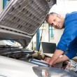 Mechanic using diagnostic tool on engine — Stock Photo #65556231