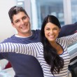 Couple standing with arms outstretched — Stock Photo #65556911