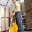 Focused man moping warehouse floor — Stock Photo #65556959