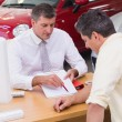 Salesman showing client where to sign deal — Stock Photo #65557307
