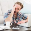 Tired man working and yawning — Stock Photo #65557319