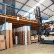 Forklift machine in large warehouse — Stock Photo #65557603