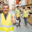 Manager smiling at camera showing thumbs up — Stock Photo #65557605