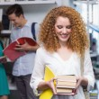 Student carrying small pile of books — Stock Photo #65557687