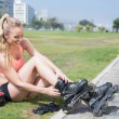 Fit blonde getting ready to roller blade — Stock Photo #65557953
