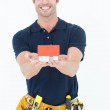 Male architect holding model home over white background — Stock Photo #65557993