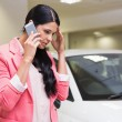 Sad woman calling someone with her mobile phone — Stock Photo #65558113