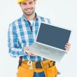 Happy construction worker showing laptop — Stock Photo #65558539