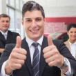 Business team one giving thumbs up — Stock Photo #65558877