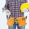 Handyman holding hard hat and hammer — Stock Photo #65559481