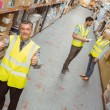 Warehouse manager smiling at camera showing thumbs up — Stock Photo #65559523