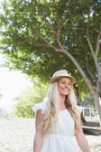 Cute blonde standing and smiling — Stock fotografie