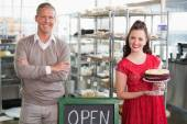 Cafe owners smiling at the camera — Stock Photo